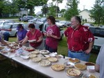 Pie servers-pat Bouthillette, Margie Cain, and Cathy and Bob Bessette