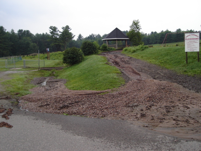 1-Two inches of rain on Thursday does damage to the Fairfax Playground.