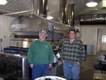 Mike Spaulding and Adam Minor in front of the heart of the operation a Dominion Grimm Boiling Rig.  This rig can produce 110 gallons of syrup per hour while it consumes 30 gallons of oil.