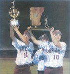 Bellows Free Academy-Fairfax baseball players Dylan Lagrow, left, and Joey Tucker hold the Bullets' trophies up at Centennial Field after they defeated Williamstown, 13-0, to win the Division III title Saturday night - This photo taken by Shawn Corrow, St. Albans Messenger was scanned from the newspaper and in no way reflects the quality of Shawn's work