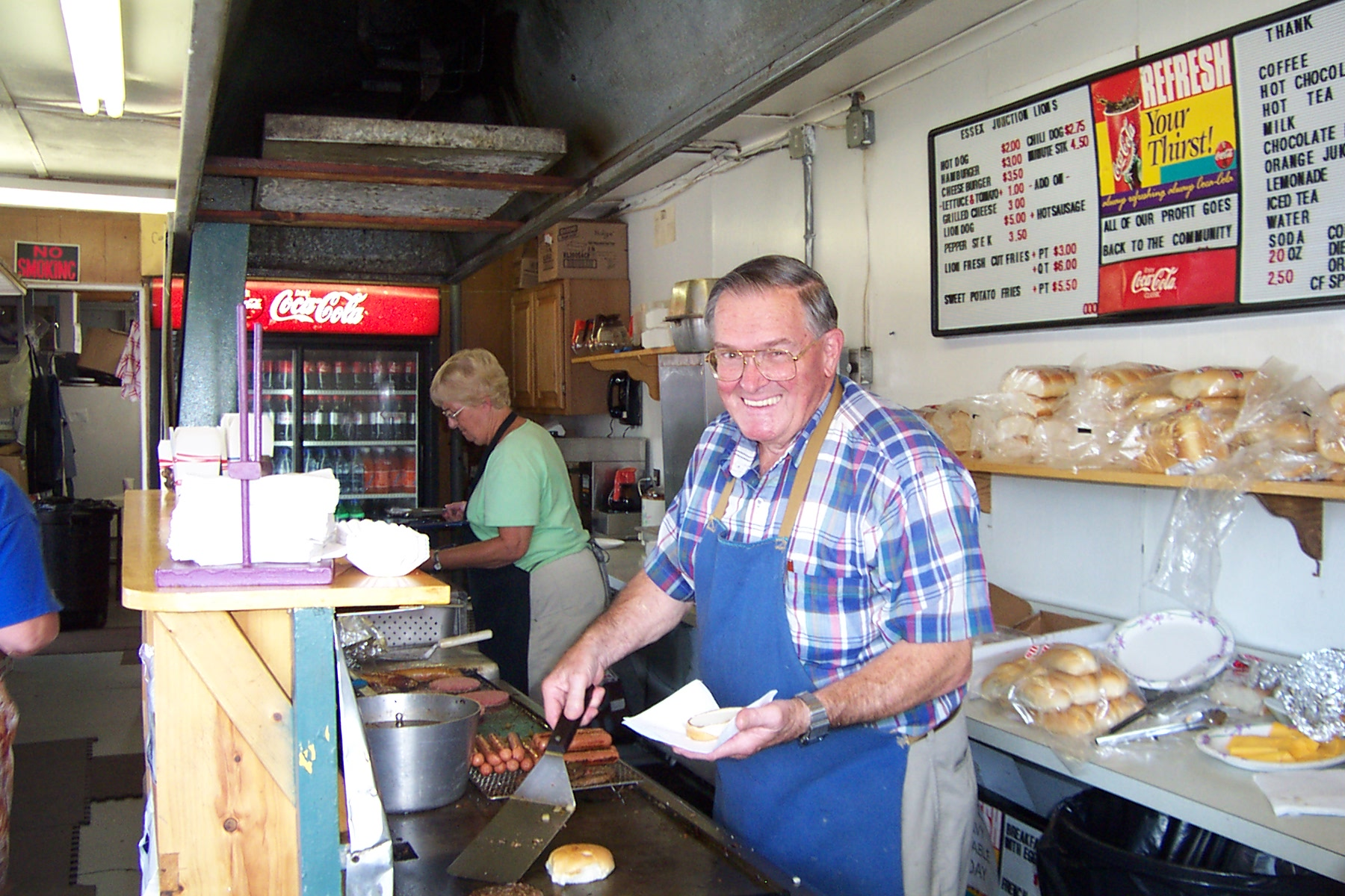 Wes Bristol was very busy cooking at the grill for the Lion's Club and seemed to enjoy his work.  Met Henry Sisters on my way out of the fair and he was coming in to work his 4-hour shift at the Lions Club Food Booth - 2007-08-31 004
