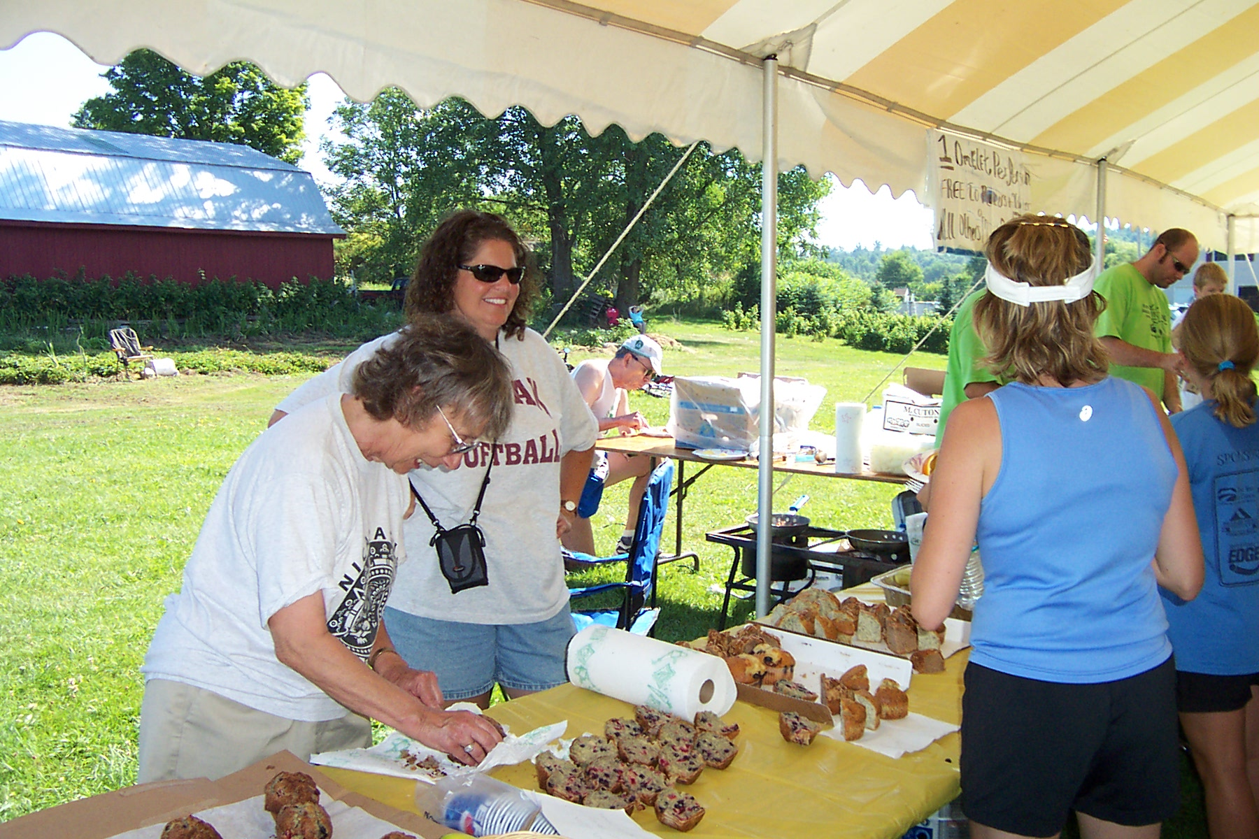 Rev. Elizabeth and Helen Hartman at the Muffin Table - Egg Run 2007 004