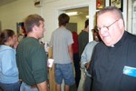 The guy in the green T-Shirt is on Fairfax Rescue and lives in Fletcher who is speaking with Father Rome - Picture 3658