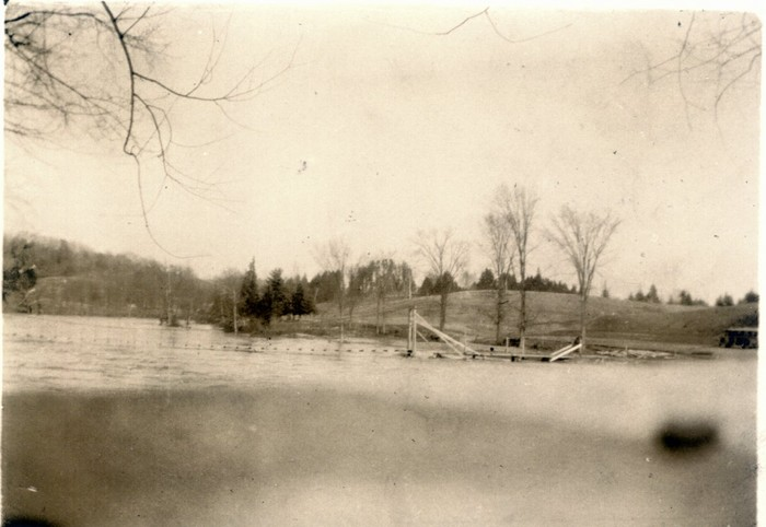 Footbridge built after the flood of 1927 across the Lamoille River at the South end of the village - Photo is courtesy of Albert Rich Albums by Sally Sweet -