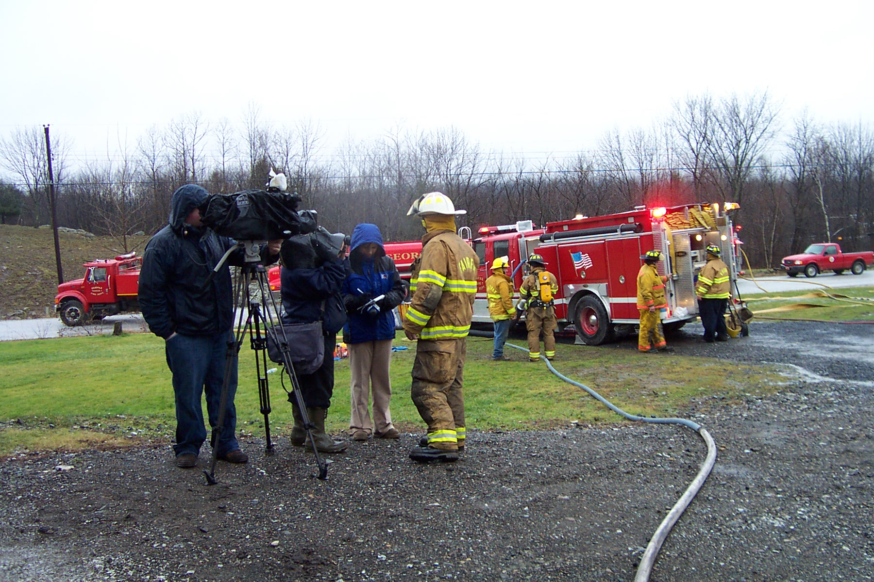 Channel 5 News in foreground with camera, then Dave St. Pierre with his camera and Channel 5 Newsperson talking with the Fairfax fireman - 2007--1-08 009