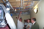 Lawyer John Franco points to plumbing where meters would be installed on the second floor that cover the third and second floors - 2007-05-25 006