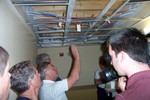 Handy's plumber, Mike Creig explains how meters would be connected to a remote location with a 24 volt thermostat type wire would provide readings for each meter - 2007-05-25 007