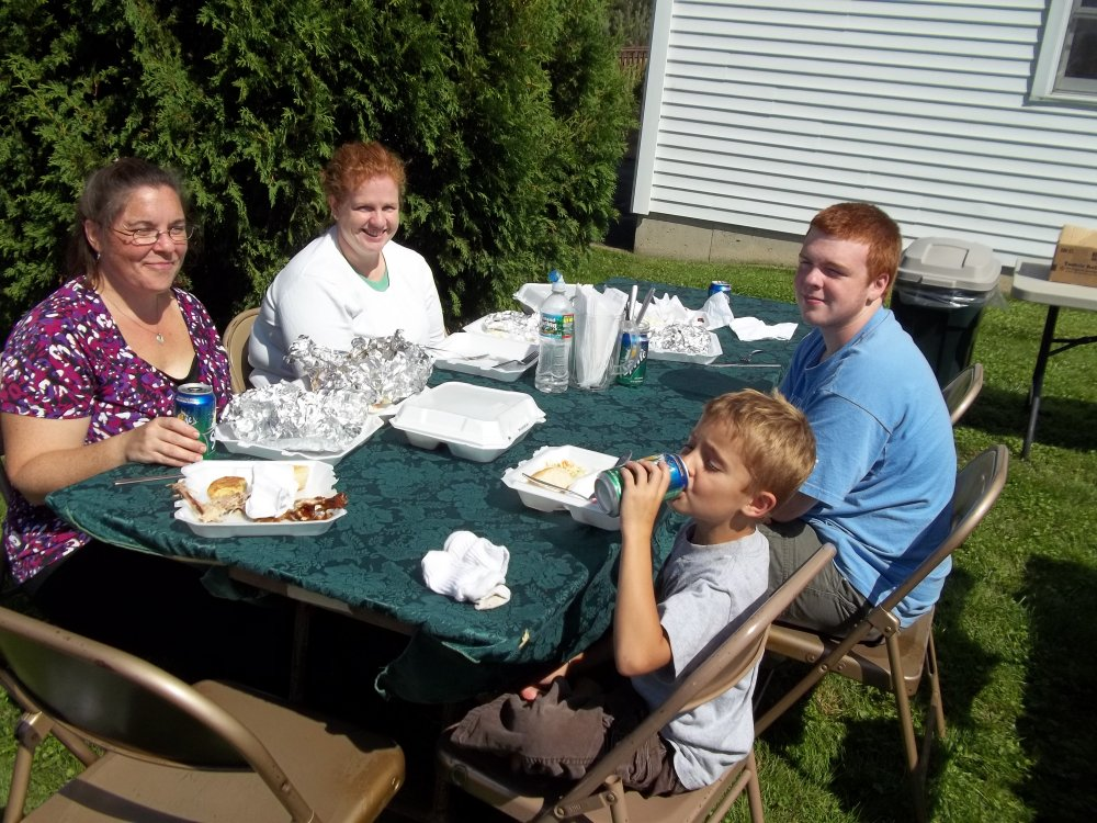 Two other families enjoy the bright sunshine & the chicken dinners -  100 0399s