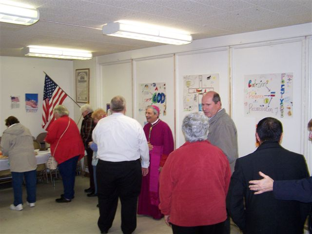 Bob Bessette talks with Bishop Matano while Guy Vanzo, Alice Collins and Fr Julian wait in line - Bishops visit 009
