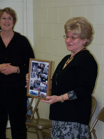Jeannette Wills & Mary McDevitt - Mary is showing the group a collage of photos of memories from St. Luke's - 100 2059