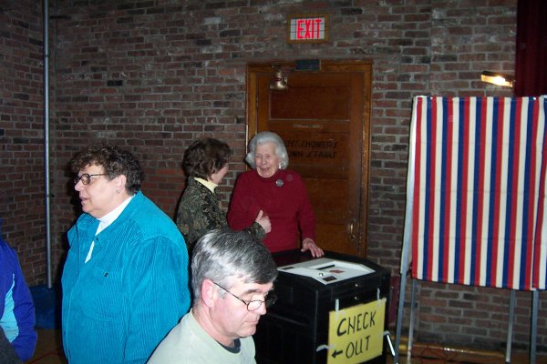 Donna Meunier and Phyllis Soule share a light moment at the voting machine