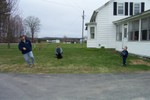 Youngsters play outside on the front yard of the Ellsworth Homestead