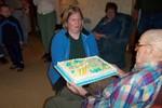 Ralph Ellsworth's admire's his grand daughter's beautiful cake