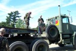 Several Guardsmen pack up and get ready to move out Sunday Afternoon, September 12, 2004