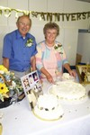 After an absolutely delicious Pot Luck Dinner, Reggie & Joyce cut the cake for the many guests in attendance