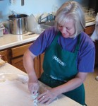 Marion Eastman cuts the dough for biscuits - senior06 070904