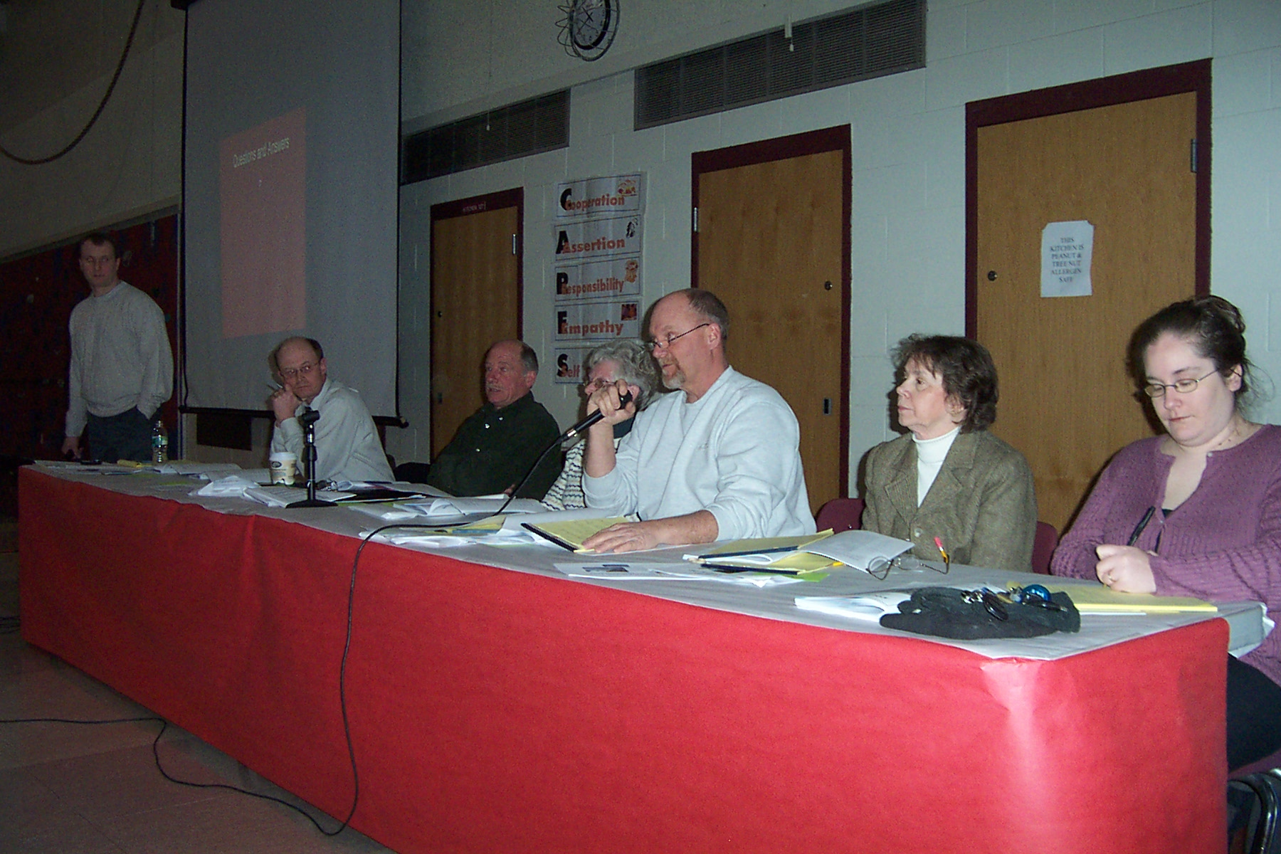 Jeff Blake, Selectboard Member responds to a question as Bill Ormerod, Charlie Swanson & Judy Cleary listen - Donna Meunier and Erin McSweeney on this end of the table - twnmeeting 2008 009