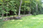 The large boulder melds right in with John Rainville's perfect stone wall - 3007-08-13 004