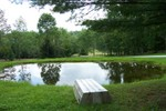 A pond adds to the peacefullness of the area along with a row boat, just in case - 3007-08-13 007