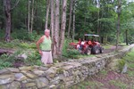 John Rainville stands near one of his stone walls that extends from the house to the Wilkins Road - 3007-08-13 014